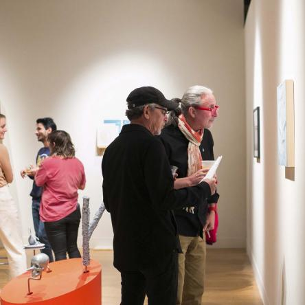 people in gallery at art opening