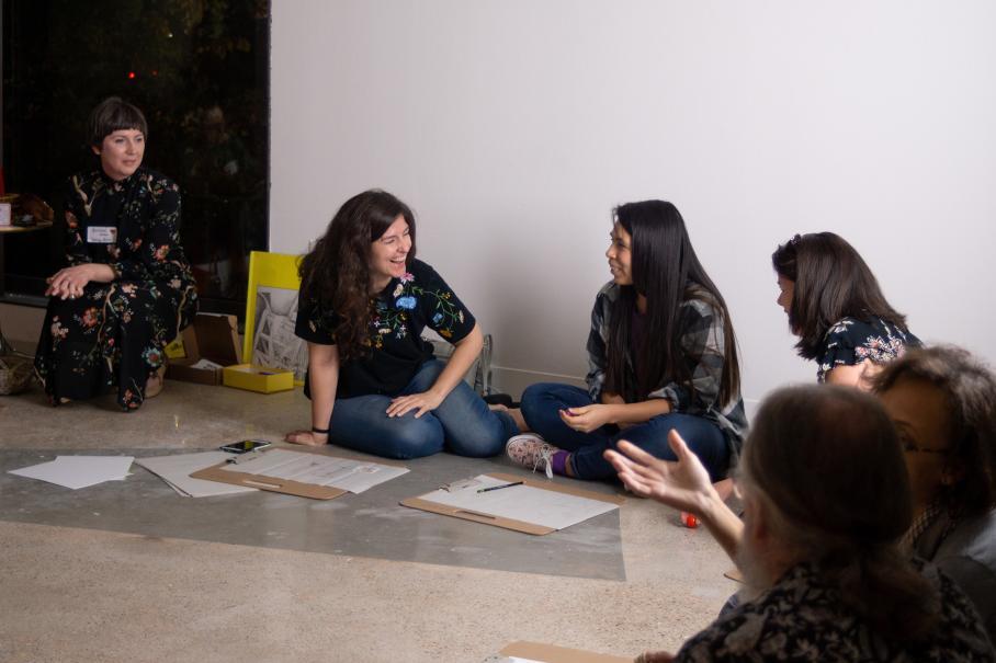 teachers talking in art gallery