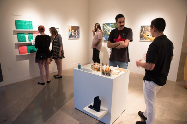 people at art gallery opening