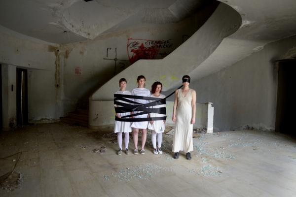 Alyssa Taylor Wendt, Visual Arts Center, photo of 4 blindfolded women in abandoned building, bound in black tape