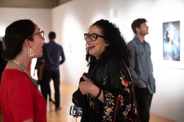 people talking at art gallery opening