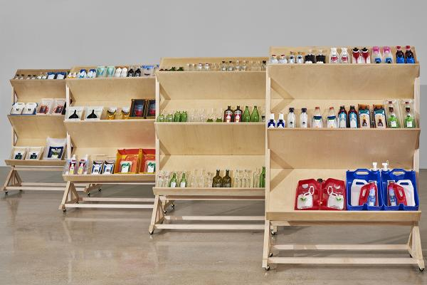 Lan Tuazon, Visual Arts Center, shelves filled with sculptures made from assorted containers
