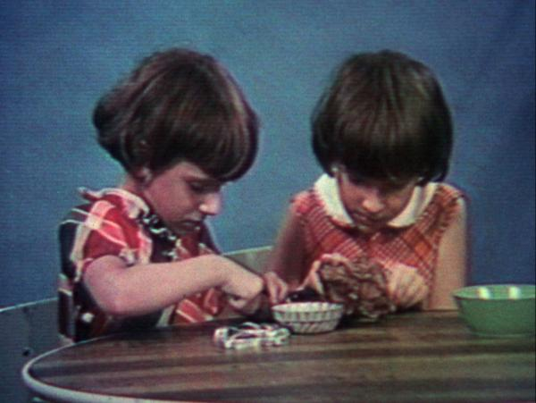 Poto and Cabengo, Visual Arts Center, film still of two young twin girls playing at table